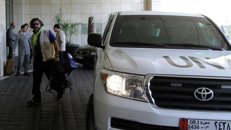 Members of the UN chemical weapons investigation team, arrive in the Syrian capital Damascus, September 25, 2013