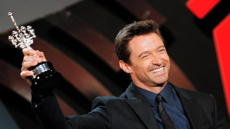 Australian actor Hugh Jackman holds the Donostia Award during the 61st San Sebastian Film Festival in the Northern Spanish Basque city on September 27, 2013.