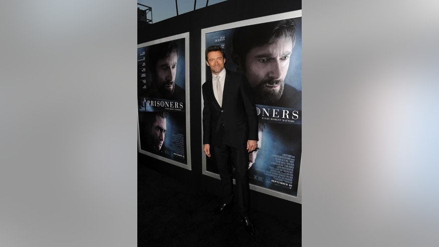 "Actor Hugh Jackman arrives at the premiere of ""Prisoners,"" at the Academy of Motion Picture Arts and Sciences in Beverly Hills, California, on September 12, 2013."