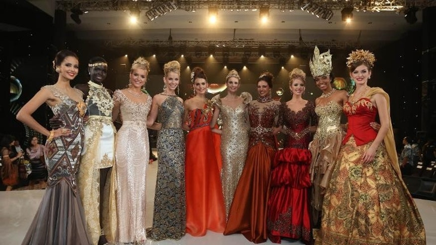 The top 10 contestants in the fashion show pose during the event at the convention center in Nusa Dua, on Indonesia's resort island of Bali on September 24, 2013.