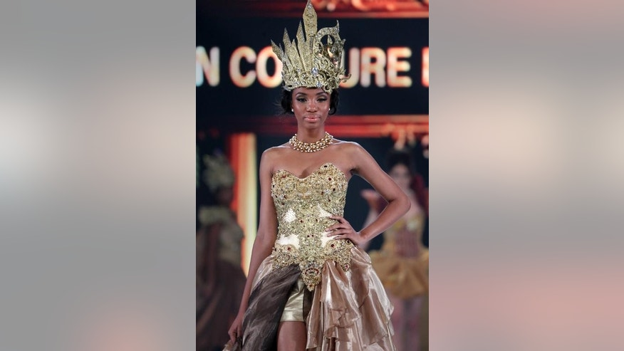 Miss Cameroon Denise Valerie Ayena, walks the catwalk during the fashion show of Miss World contestants at a convention center in Nusa Dua, on Indonesia's resort island of Bali on September 24, 2013.