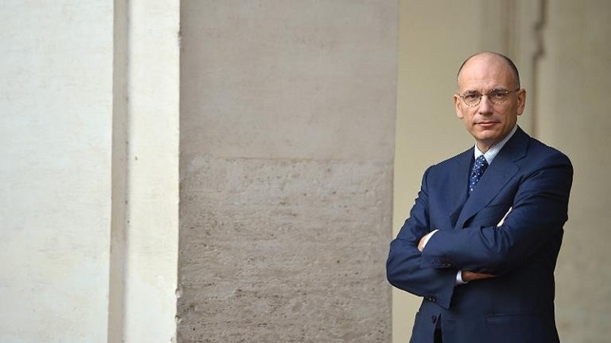 Italian Prime Minister Enrico Letta, pictured in Rome on September 18, 2013, will call for parliament to express support for the government next week in a bid to end a crisis which has driven the bickering ruling coalition to the brink of collapse