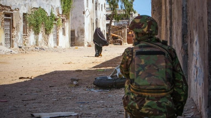 A Kenyan soldier serving with the African Union Mission in Somalia keeps watch on a street in the southern Somali port city of Kismayo on October 5, 2012, in a photo released by the African Union-United Nations Information Support Team