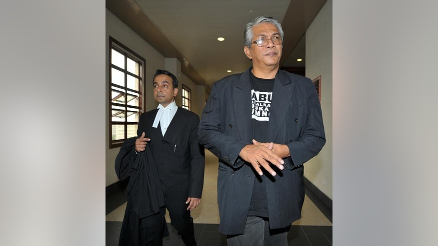 File photo of Malaysian social activist Haris Ibrahim at the High Court in Kuala Lumpur on May 29, 2013. Ibrahim, who faces sedition charges at home has said he was denied a visa to enter Australia.