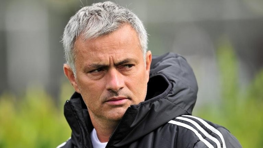 Chelsea manager Jose Mourinho attends a training session at the team's training ground in Stoke D'Abernon, south London, on September 17, 2013.