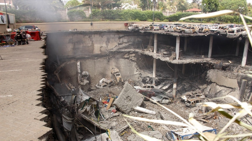 Sept. 26, 2013 - Collapsed upper car park of the Westgate Mall in Nairobi, Kenya. Working near bodies crushed by rubble in a bullet-scarred, scorched mall, FBI agents continued fingerprint, DNA and ballistic analysis to help determine the identities and nationalities of victims and al-Shabab gunmen who attacked the shopping center, killing more than 60 people. Photo released by Kenya Presidency.