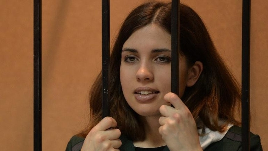 """Pussy Riot"" punk Nadezhda Tolokonnikova waits in the defendant's cage at a courthouse in Zubova Polyana, on April 26, 2013"