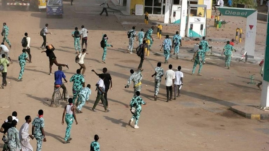 Sudanese protestors throw stones at a petrol station in Khartoum's twin city of Omdurman on September 25, 2013 during a demonstration after the government announced steep price rises for petroleum products after suspending state subsidies
