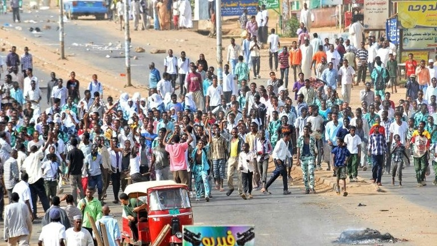 Sudanese protestors demonstrate in Khartoum's twin city of Omdurman on September 25, 2013 after the government announced steep price rises for petroleum products after suspending state subsidies
