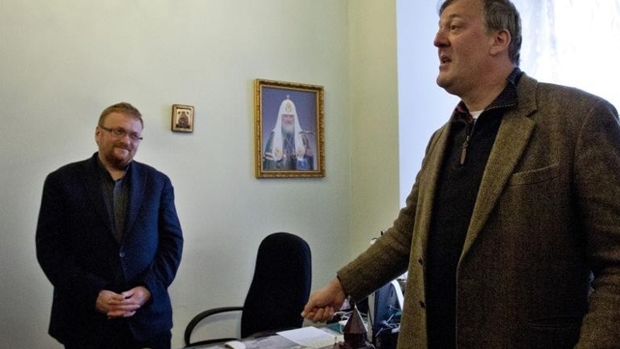British actor Stephen Fry (R) speaks with Russian lawmaker Vitaly Milonov (L) in Saint Petersburg, on March 14, 2013. Milonov says he believes Fry is a ???bringer of evil???, thinks homosexuality is a perversion.