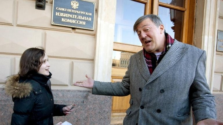 British actor Stephen Fry speaks outside the city parliament in Saint Petersburg, on March 14, 2013.