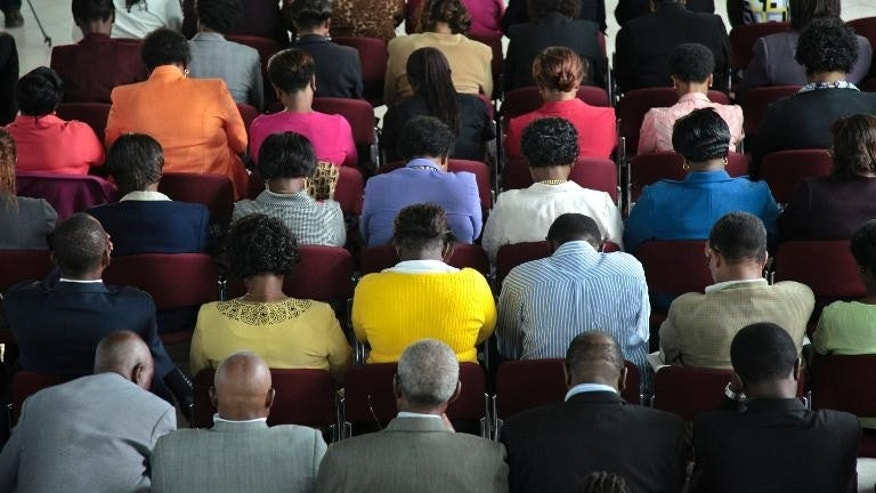 Kenyan mourners attend a prayer service held at St. Andrews Church in Nairobi on September 26, 2013