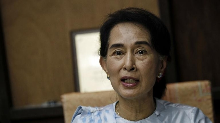 Myanmar opposition leader Aung San Suu Kyi addresses reporters at the National League for Democracy (NLD) headquarters in Yangon on September 27, 2013