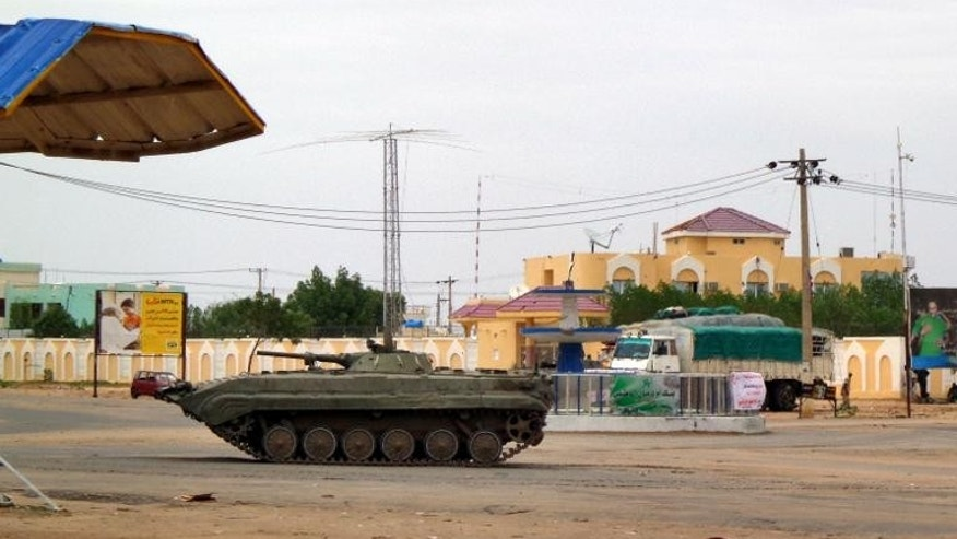 Sudnaese military tank is stationed near a Sudanese security facility in the city of Nyala, in the Darfur region, on July 4, 2013.