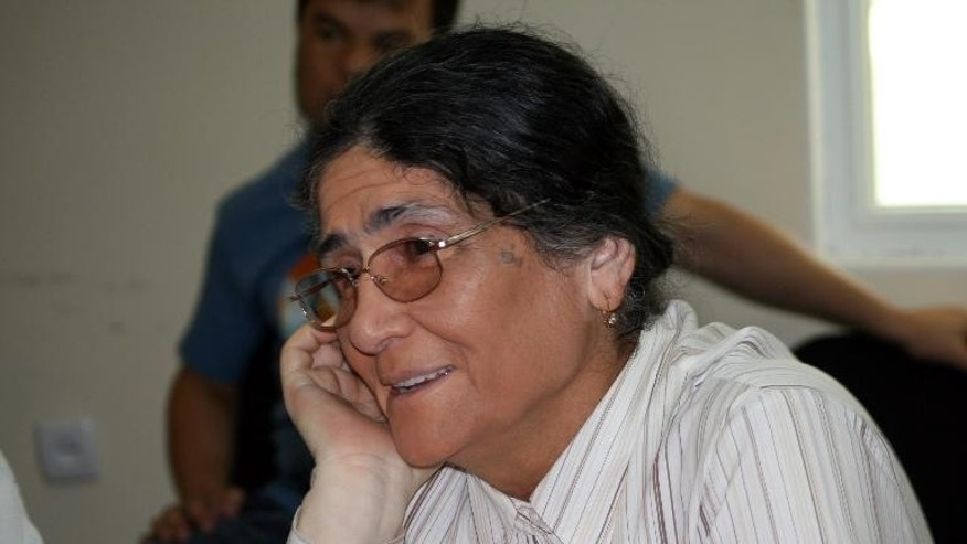 Tajik lawyer and rights activist Oinikhol Bobonazarova attending a meeting Dushanbe on July 15, 2013