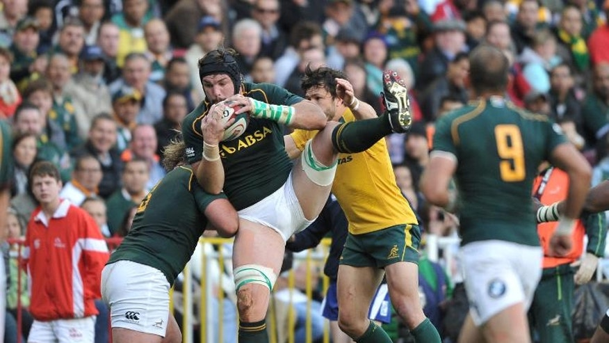 Flip van der Merwe of South Africa (C) catches the ball during the 2013 Rugby Championship match between South Africa and Australia at the Newlands Stadium on September 28, 2013 in Cape Town, South Africa.