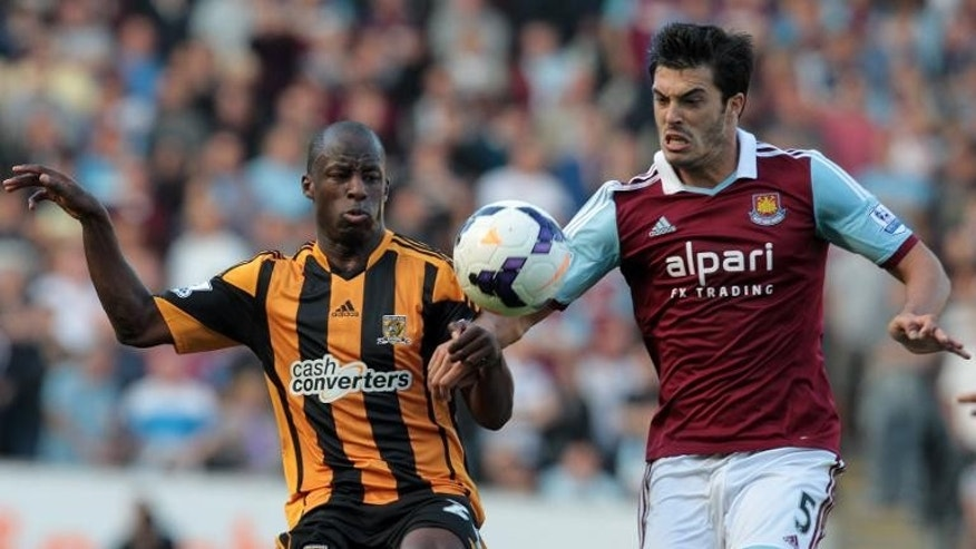 Hull City's Nigerian midfielder Sone Aluko (L) vies with West Ham United's English defender James Tomkins on September 28, 2013.