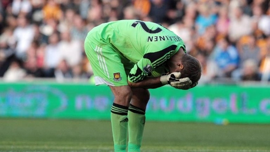 West Ham United's Finnish goalkeeper Jussi Jaaskelainen reacts after losing 1-0 to Hull City on September 28, 2013.