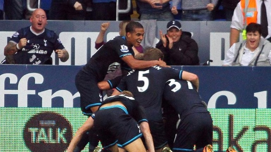 Tottenham Hotspur players celebrate Brazilian midfielder Paulinho's winning goal in Cardiff City on September 22, 2013.