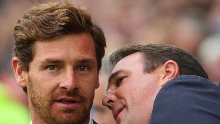 Tottenham Hotspur manager Andre Villas-Boas (L) and Cardiff City's Scottish manager Malky Mackay at The Cardiff City Stadium in Cardiff on September 22, 2013
