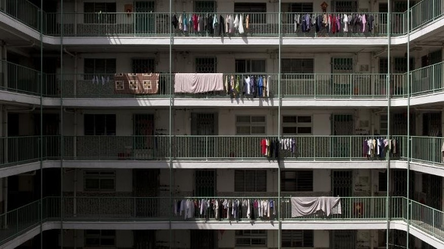 A photo taken on July 2, 2013 shows laundry drying on railings in a Kowloon government housing estate in Hong Kong