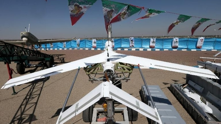 "A handout picture released by Iran's ISNA news agency shows the new Iranian-made highly mobile propellant-powered reconnaissance drone named ""Yasseer"", in Tehran, on September 28, 2013"