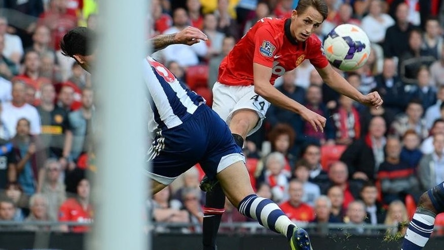 Manchester United's Adnan Januzaj (R) attempts a shot at goal during their English Premier League match against West Bromwich Albion at Old Trafford in Manchester on September 28, 2013 which West Bromwich won 2-1.