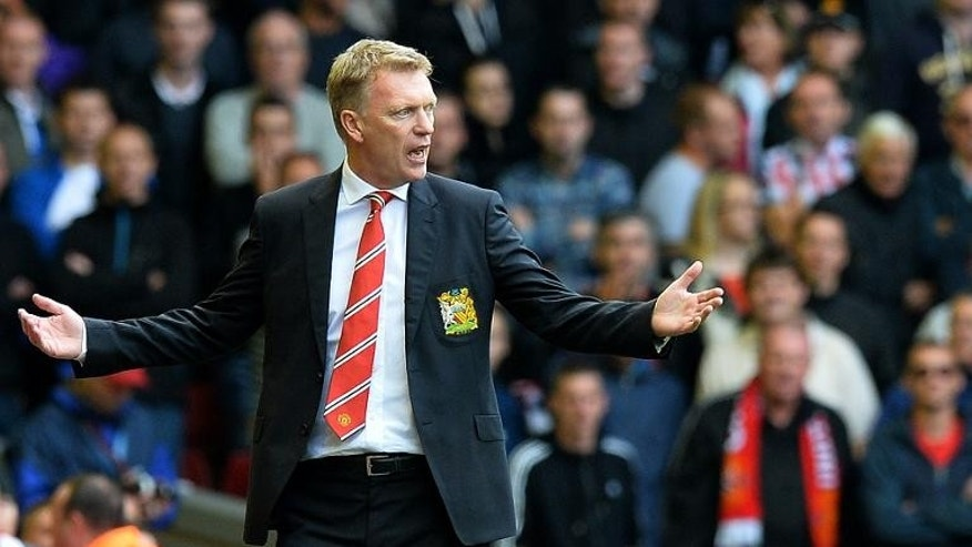 Manchester United's Scottish manager David Moyes reacts during the English Premier League football match between Liverpool and Manchester United at the Anfield stadium in Liverpool, northwest England, on September 1, 2013.