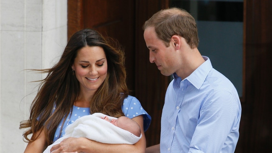 July 23, 2013: Britain's Prince William, right, and Kate, Duchess of Cambridge hold the Prince of Cambridge, in this file photo as they pose for the media outside St. Mary's Hospital's exclusive Lindo Wing in London where the Duchess gave birth on Monday July 22.