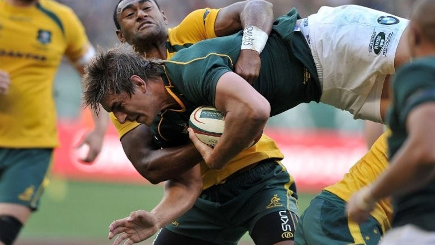 Eben Etzebeth of South Africa makes a diving lunge into the Australian defence during their 2013 Rugby Championship match at the Newlands Stadium on September 28, 2013 in Cape Town, which the Springboks won 28-8