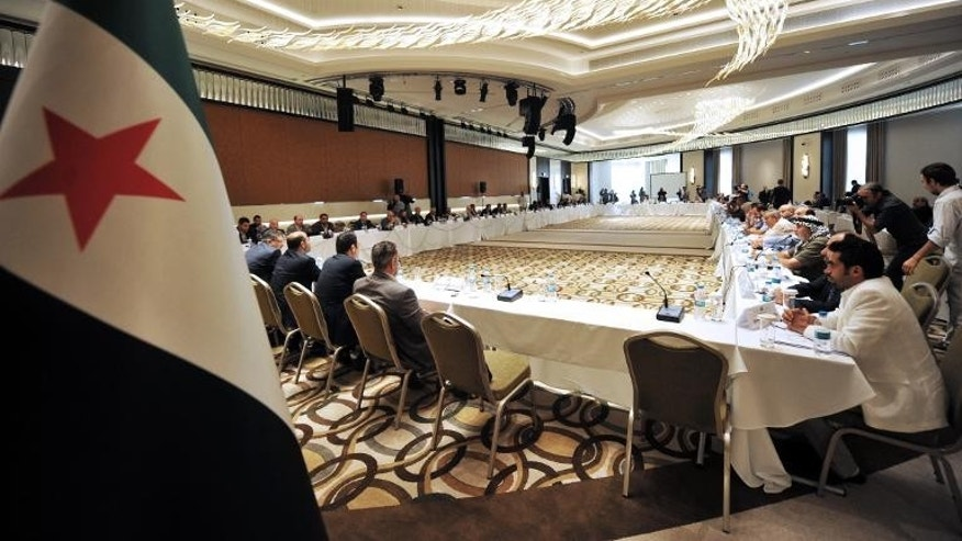 Members of Syrian National coalition (SNC) attend a meeting of the National Coalition of Syrian Revolution and Opposition forces on September 13, 2013, in Istanbul.