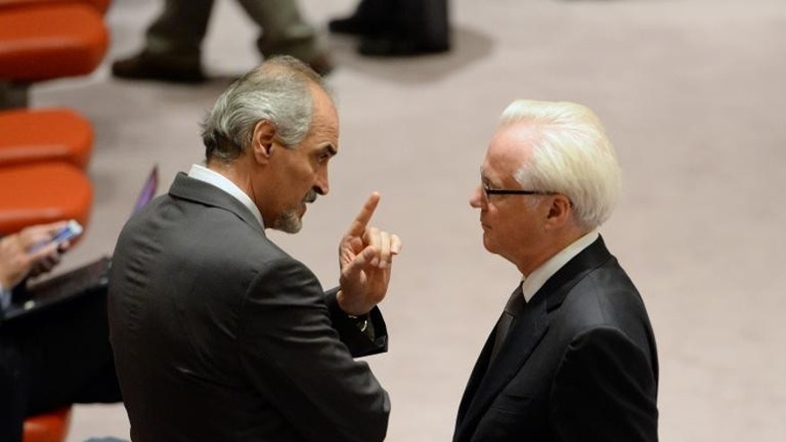 Bashar Ja'afari (L), Syria's Ambassador to the United Nations, speaks to Vitaly Churkin (R), Russia's Ambassador to the UN in the United Nations Security Council on September 27, 2013 at UN headquarters in New York.