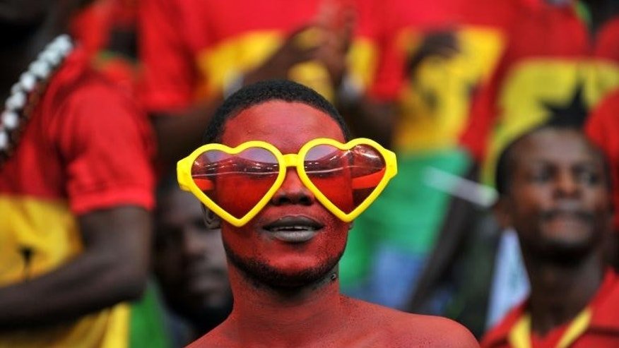 A Ghana supporter cheers on his team during the FIFA Under 20 World Cup third-place football match against Iraq at Turk Telecom stadium in Istanbul on July 13, 2013