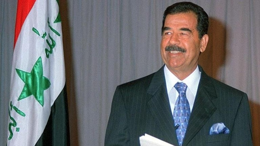 Iraqi President Saddam Hussein delivers a televised speech in 1998 -- the year a company owned by the Reserve Bank of Australia attempted to strike a business deal with him