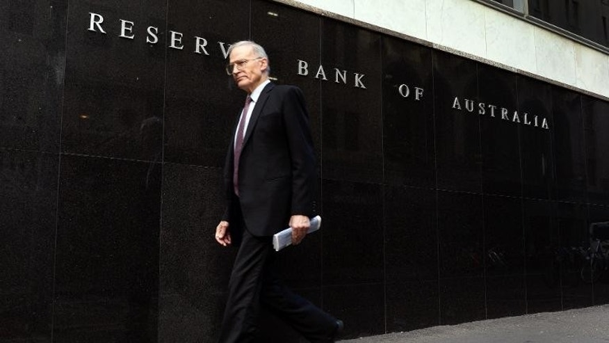 A man walks past the Reserve Bank of Australia on May 7, 2013