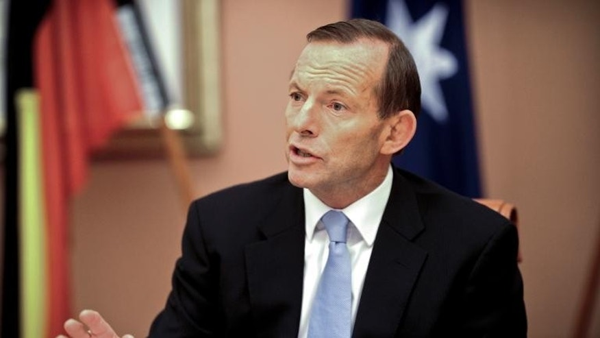 Prime Minister Tony Abbott speaks during the first meeting of the full ministry at Parliament House in Canberra on September 18, 2013