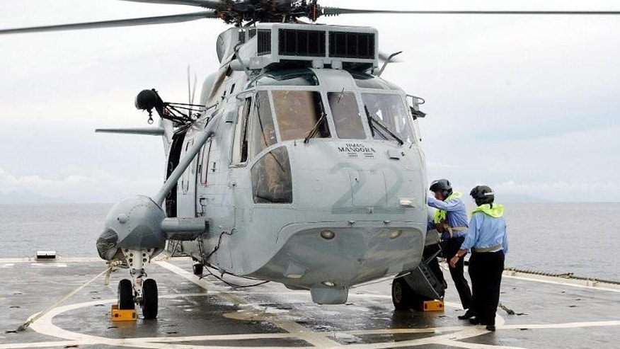 Illustration: a navy helicopter was scrambled to save two French sailors after their vessel sank 360 miles off the coast of Australia