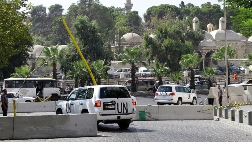 A convoy of United Nations vehicles carrying chemical weapons experts in Damascus on September 29, 2013, to investigate the alleged use of banned arms.