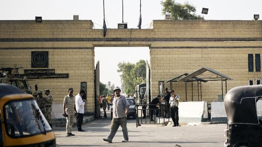 Members of Egyptian security forces stand guard outside the Tora prison on August 21, 2013 in Cairo.