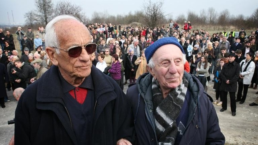 Jan Dresner (left) and Ludwik Kutcher, two Jews saved from the Holocaust by German industrialist Oskar Schindler are pictured in the former Nazi concentration camp of Plaszow on March 16, 2008