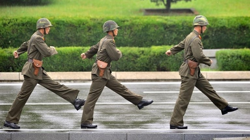 North Korean soldiers march at the truce village of Panmunjom in the Demilitarized zone dividing the two Koreas on September 11, 2013.