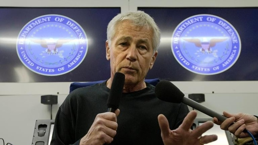 US Secretary of Defense Chuck Hagel speaks to the press aboard a US military aircraft plane en route to Seoul, South Korea, on September 29, 2013