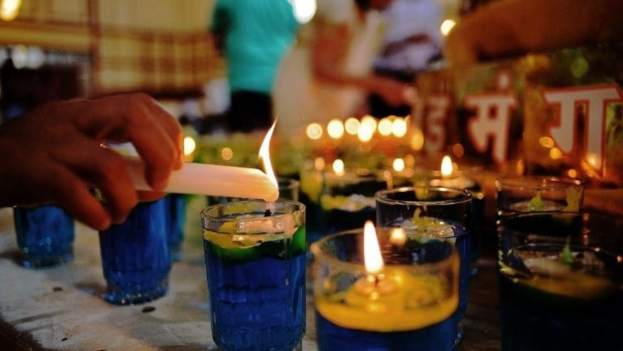 A candle is lit at Nairobi's Oshwal centre at the start of a Jain prayer vigil for victims of the Westgate mall massacre on September 28, 2013