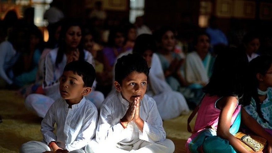 A young boy prays at Nairobi's Oshwal centre at the start of a Jain prayer vigil for victims of the Westgate mall massacre on September 28, 2013