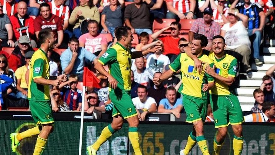 Jonathan Howson (2nd right) is congratulated by teammates after scoring for Norwich against Stoke at the Britannia Stadium on September 29, 2013