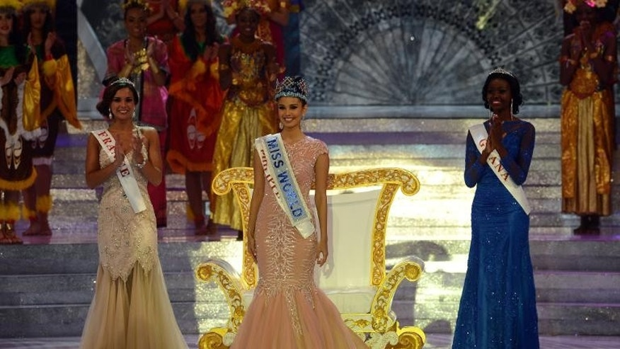 Megan Young (centre) from the Philippines poses after winning the Miss World title in Nusa Dua, on the Indonesian island of Bali on September 28, 2013