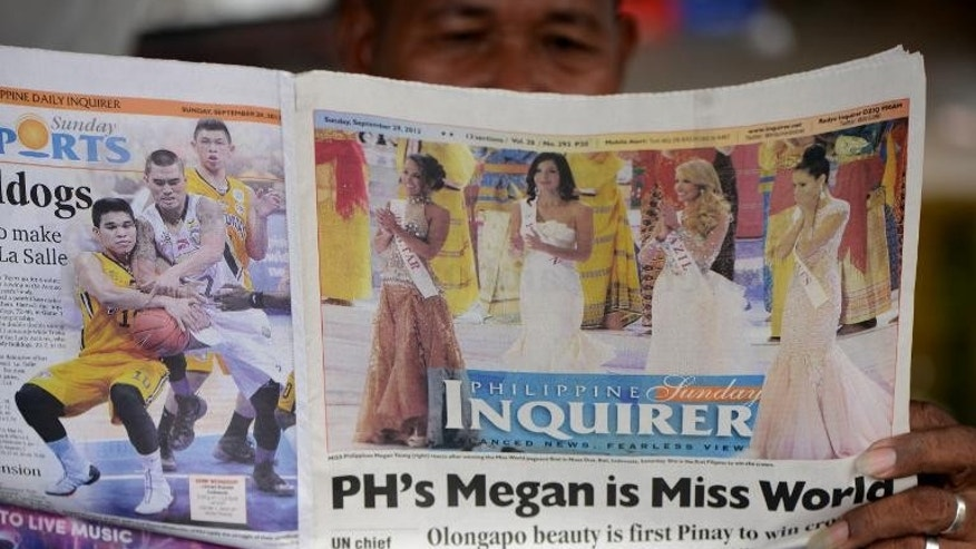 A Philippines newspaper on september 29, 2013, celebrates Megan Young's victory in the Miss World contest