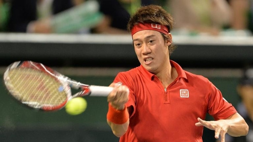 Japan's Kei Nishikori returns a shot against Santiago Giraldo of Colombia during their singles match in Tokyo on September 15, 2013