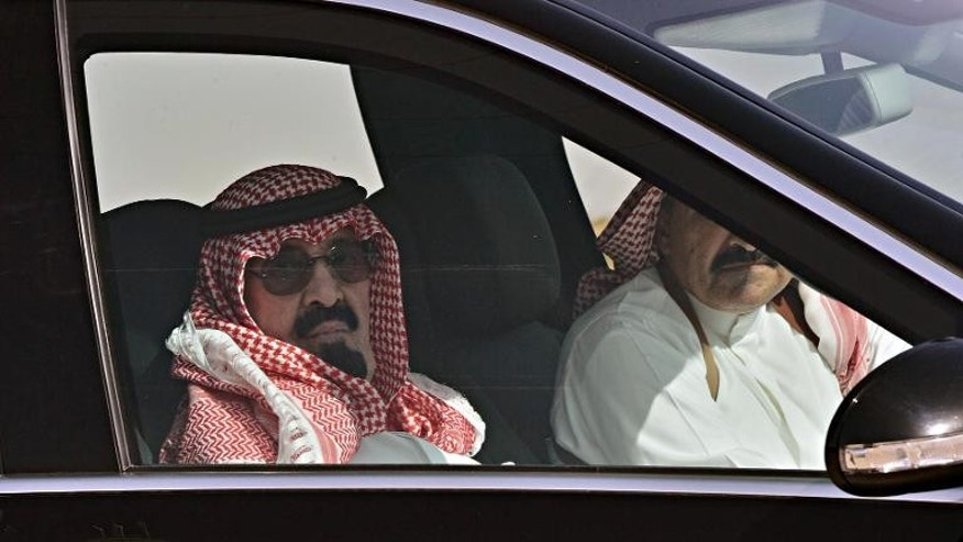 A picture released on March 3, 2013 shows King Abdullah bin Abdulaziz al-Saud arriving at Rawdat al-Khuraim to visit his farm