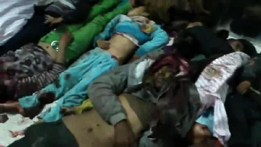 An image grabbed from a YouTube video on December 26, 2012 said to show bodies after the shelling of Kahtaniyeh west of Raqa